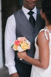 bride holding a fabric flower bouquet