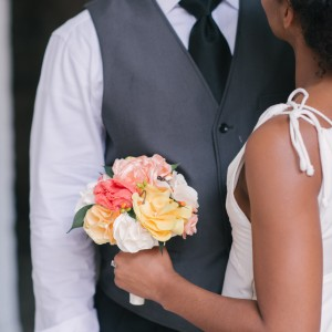 bride holding a fabric flower bouquet